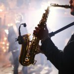 Man plays saxophone in event